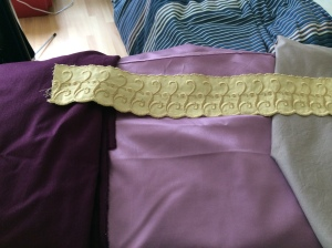 Left to right: Underskirt fabric, main fabric, bodice lining, and trim