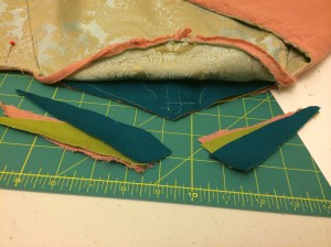 Here are the bits left after cutting. The blue and green are both cotton canvas remnants from Joann, and the pink is an annoying-loose weave linen-look that I picked up for a dollar at a theater sale.