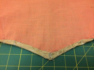 You can see way on the side where the facing and main fabric connect.